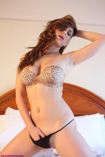 Shay Laren Lies Back On Her Bed 04