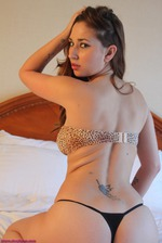 Shay Laren Lies Back On Her Bed 05