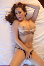 Shay Laren Lies Back On Her Bed 08