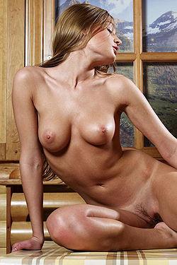 Nika Hot Naked Girl Posing On A Table