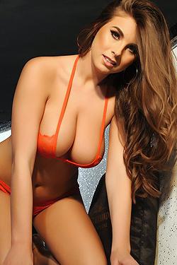 Sarah McDonald In A Orange Bikini