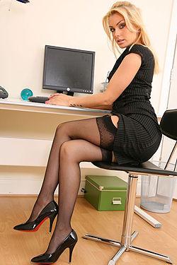 Blonde Secretary In Black Dress