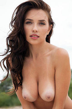 Busty Brunette Niemira Posing Naked On The Beach
